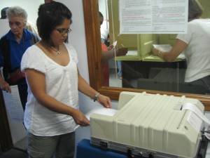 Inserting Ballots into Machines to be read